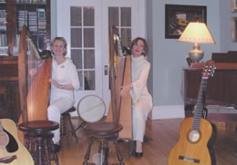 Janine and Susan performing at a house concert