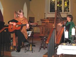 Janine on guitar, Susan on harp at winter 2008 concert